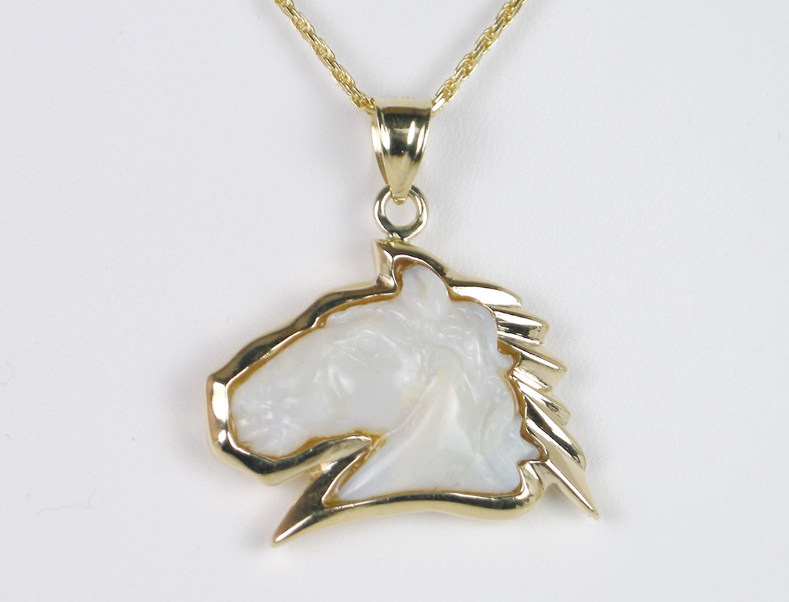 Carved opal horse's head pendant