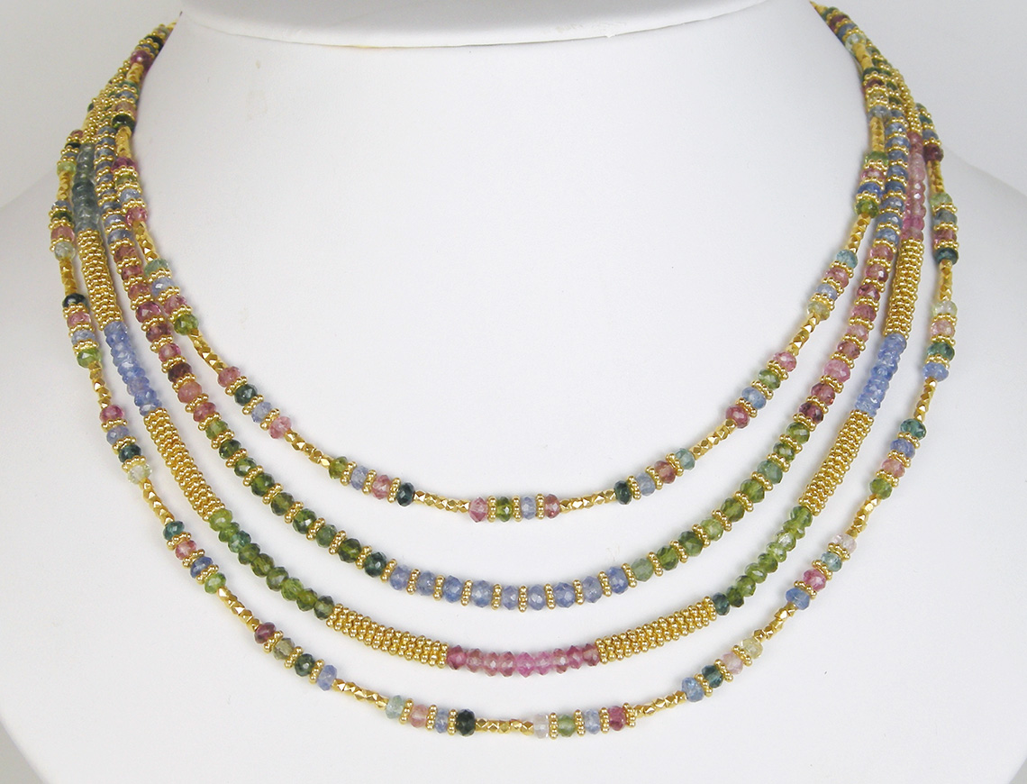 Multi strand necklace by Laura Gibson