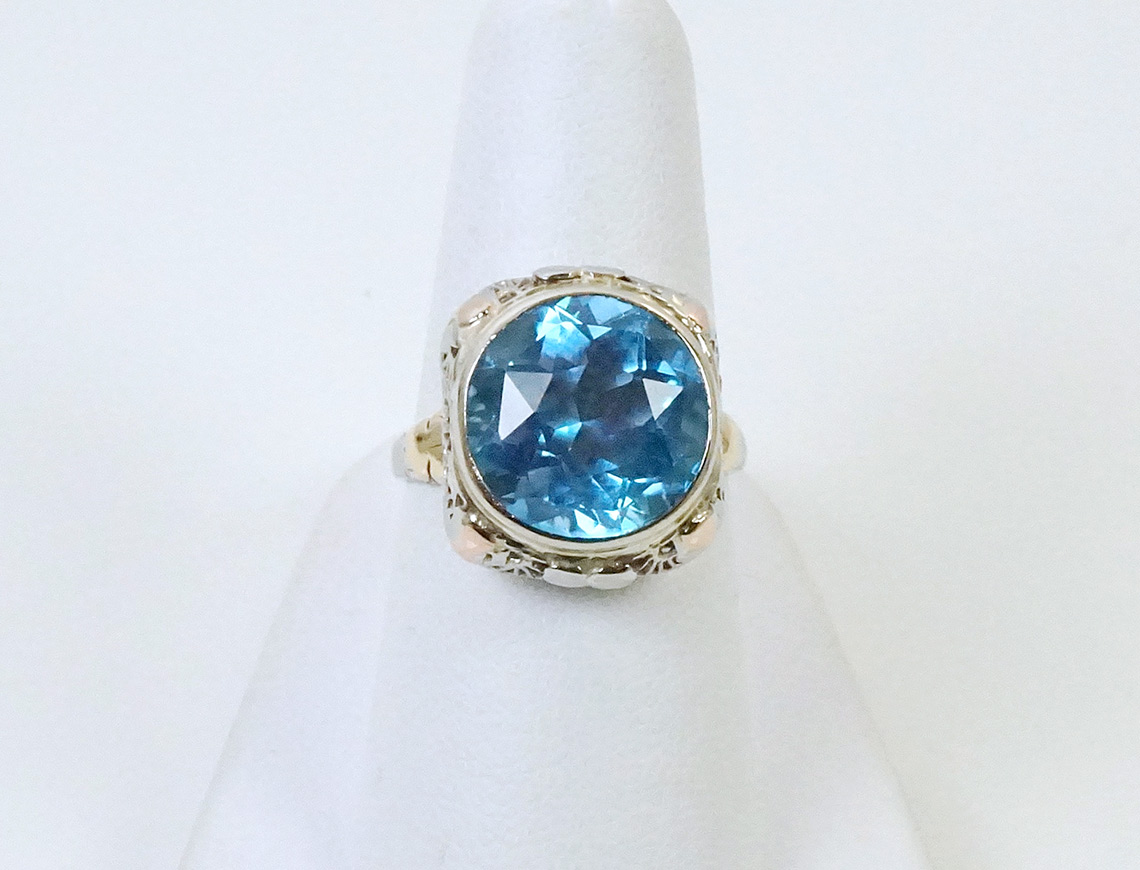 Vintage filigree ring with blue topaz