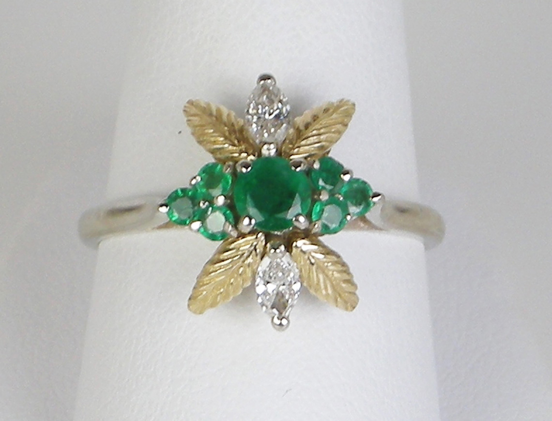 Cute emerald and diamond ring