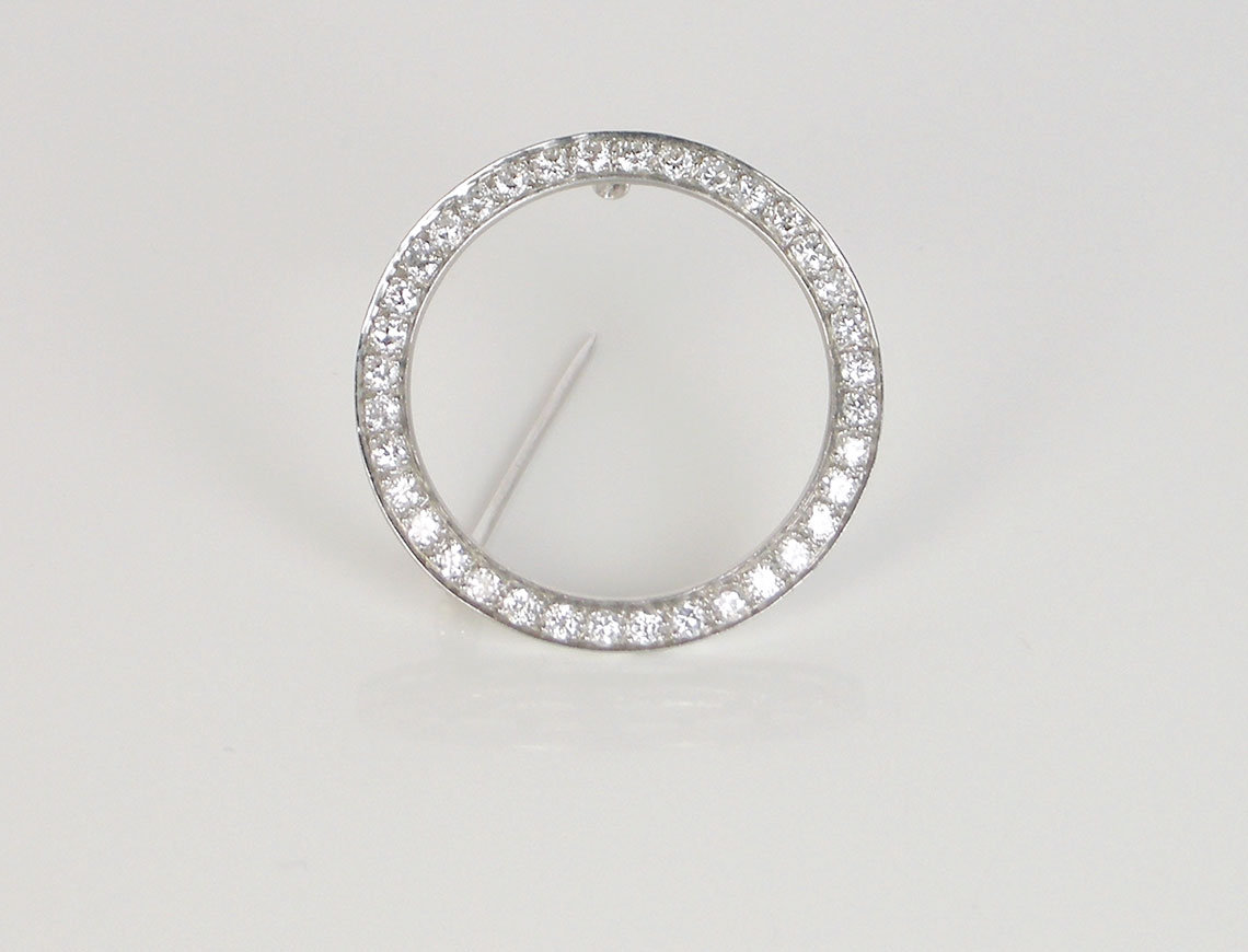 Classic platinum and diamond circle pin