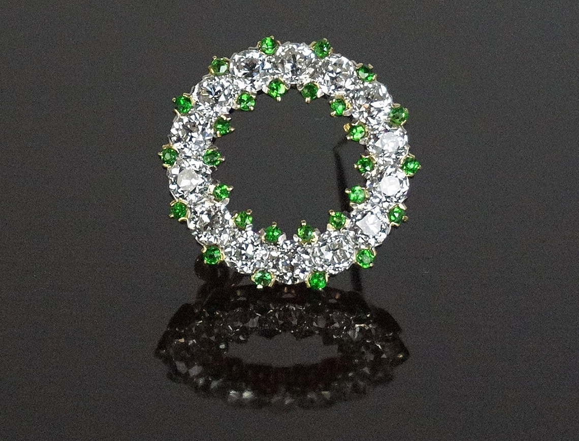 Diamond and demantoid garnet circle pin ca. 1900