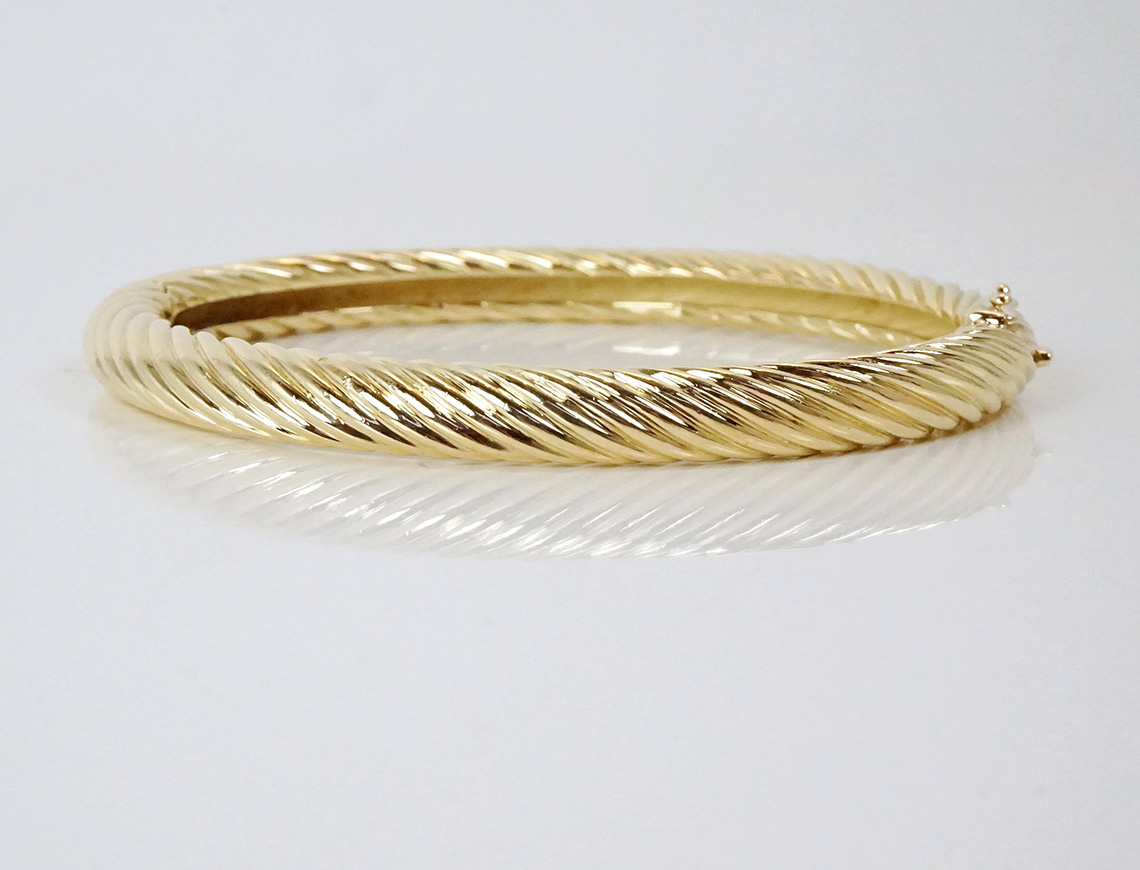 Cartier hinged bangle with a twist